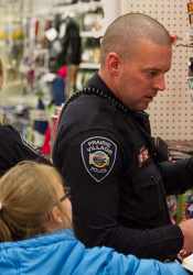 Prairie VIllage police officers helped 10 local kids shop for themselves and their families at the Mission Target Thursday afternoon.
