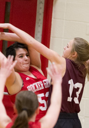 Indian Hills' Addie Von Drehle plays tough defense against Hocker Grove.