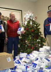 Representatives of the Uplift Organization and St. Michael's Episcopal Church  loaded whiite socks to help the homeless at the Sylvester Powell Community Center.