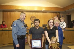 Mission Police Chief Ben Hadley presented the award to Angel Torres-Molina who rescued Cassandra Ballard. With Ballard for the presentation were her children, mother and brother.