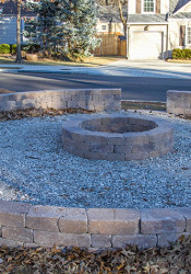 A circular fire pit structure on the Oxford Road and Prairie Lane traffic island was built without approval of the city, which owns the land.