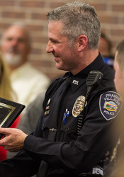 Officer Brian Wolf received the Award of Valor — the highest given by the Prairie Village Police — for his part in apprehending the Bank of America robbers.