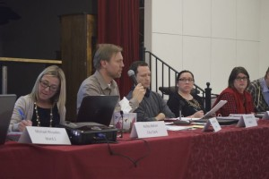 Mayor Joel Marquardt spoke about the conflict over chair of an ad hoc committee while Councilors Ryan Kellerman and Megan England listen.