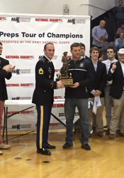 SM East football coach Dustin Delaney received the MaxPreps Tour of Champions award from Kansas Army National Guard Sergeant First Class James Elam at halftime of Friday's SM East-SM West basketball game. Photo via SME Athletics Twitter.