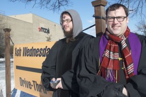 Shea Zellweger and Senior Minister Aaron Roberts were on hand early today to provide the drive-through Ash Wednesday service at Colonial Church.