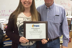 Julia Poe and SM East journalism adviser Dow Tate. Photo via KSPA.