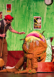 Seymour, played by Austin Dalgleish, and Mushnik, played by Tyler Armer, admire a fully grown Audrey II, the blood thirsty plant.