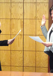 Laura Wassmer took the oath of office from City Clerk Joyce Hagen Mundy on Monday.