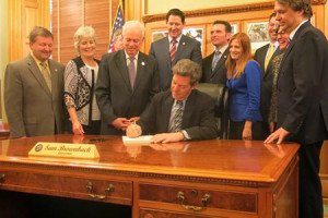 Gov. Sam Brownback signed the block grant bill this week. Photo via governor's office.