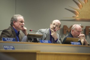 Merriam Councilor John Canterbury (C) listens to Al Frisby during the trash container discussion Monday. Scott Diebold is at right.