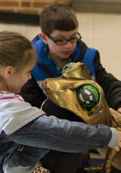A puppet frog snuck in for a kiss at the Prairie Village Earth Fair Saturday.