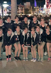 The Lancer Dancers with their second place trophy. Photo via Lancer Dancers Twitter.