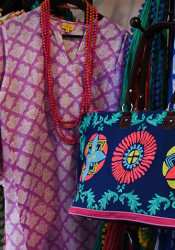 The Little Flower Shop's racks are full of bright, colorful swimsuit covers and beach bags, the perfect Spring Break accessories.