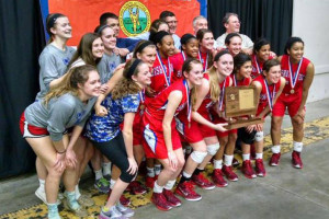 The Miege girls celebrated their undefeated season in Salina Saturday. Photo via Bishop Miege Facebook.