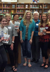 Author Amy Engel, center in turquoise sweater, visited SM East's Mother-Daughter Book Group Thursday.