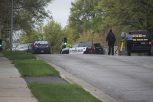 A Prairie Village police car appeared to have collided with the suspect's vehicle following the early morning Sunday arrest as investigators canvassed the area.