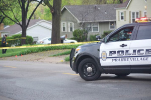 Crime scene investigators scoured the area around 75th Street and Belinder after Sunday's early morning shooting.