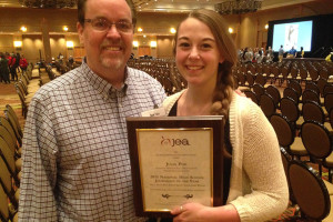 Dow Tate, left, and National High School Journalist of the Year Julia Poe with her award in Denver. (Photo courtesy Julia Poe).