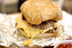 Five Guys is known for its delicious, straightforward burgers. Photo by Tiffany Bailey via Flickr.