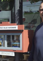 Kelly Mack of Mack Hardware on Johnson Drive and the store's Little Free Library.