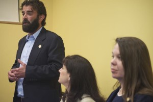 Rep. Jarrod Ousley speaking Saturday morning as Rep.s Melissa Rooker and Stephanie Clayton listen.