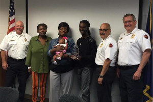 Alex Harper, center, shown with his girlfriend, mother and daughter, received the Don Harper Meritorious Service Award from Consolidated Fire District No. 2.