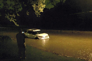 Rising waters on State Park Road in Fairway stranded this car Saturday.