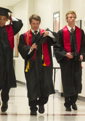 Enrique Franco (left) adjusted his cap as he walked into the SM North auditorium for the start of graduation ceremonies Wednesday.