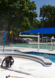 Workers put some finishing touches on the new kids swimming area at the Fairway pool Monday.