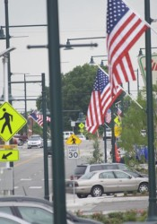 American flags line downtown Mission along Johnson Drive today.