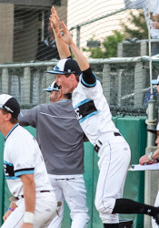 The Lancers' dugout erupted with joy when Max Sanborn, playing third in the seventh inning, recorded the final out by tagging a Blue Valley baserunner.