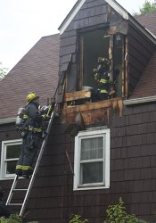 Firefighters worked on a house fire in Roeland Park this morning, taking out the wall in an upstairs bathroom.