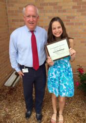 Indian Hills Principal Scott Sherman and Wally Award Winner Lucy Hoffman.