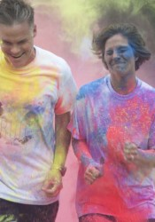 The finish line at the SM East Color Run was an opportunity to get doused again.