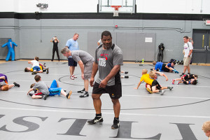 "Douglas told the camp participants that one of the keys to success was ""not being afraid to get your butt whooped in practice."""
