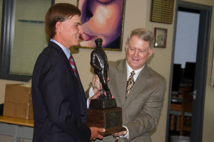 Andy Spencer received the Kenneth Smith Award from Kenneth Smith Golf's Patrick McMahon in the SM East library Wednesday.