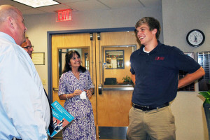 Bishop Miege administrator Randy Salisbury, president Dr. Joe Passantino, and guidance counselor Elaine Schmidtberger delivered the news to Nolan Gray that he was a National Merit Semifinalist. Photo via Bishop Miege Facebook.
