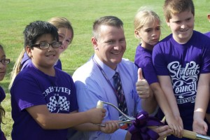 Crestview Principal John Bartel and some students show off the ceremonial shovel.