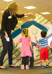 Library staff had plenty of help unveiling the new 6 by 6 play area at the Antioch Library in Merriam Saturday.