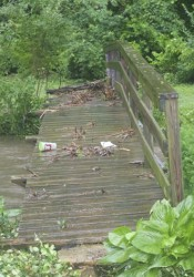 When flood waters receded in June, they left the bridge damaged.
