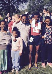 The Akalu family celebrated after Belesti and Alex's speedy performances Saturday. Photo via SM North Athletics Twitter.