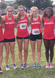 SM North's girls cross country team celebrated their third place finish among the field of 31. Photo via Gretchen Burchstead via Twitter.