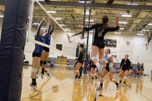 SM East's Ellie Booton sets up for a spike against Olathe Northwest.