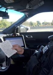 Merriam Police Officer Aaron Simmons shows a print out from the digital ticketing system.