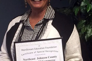 Northeast Johnson County Chamber President Deb Settle with the certificate of recognition from the MainStream Coalition.