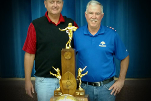 Kelly Goodburn (left) with high school teammate Dave Nissen at the ceremony to present the golden football at his Iowa high school.