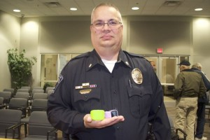 Merriam Police Major Darren McLaughlin shows the wristband and watch to help track a person with autism who may wander away.