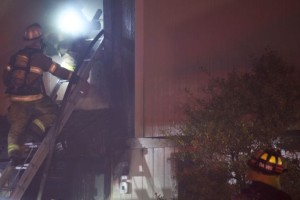 Firefighters enter the second floor of the apartment where the fire started.