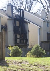 The apartment shows fire damage on the side where the deck is located.