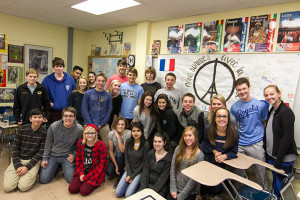 Laure Losey's French III students pose by a banner they made to show solidarity with their French pen pals in the wake of the Paris attacks.